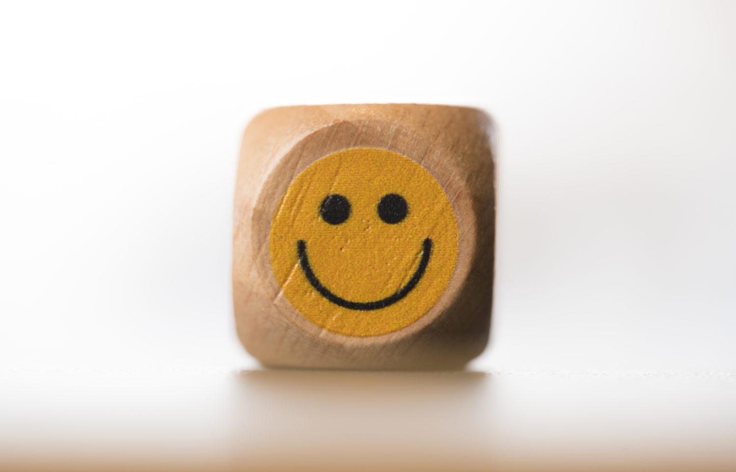 Beautifully crafted wooden dice with a different emoticon on each face